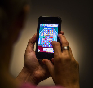 LOS ANGELES, CA - MAY 16, 2013 - A person playing the Candy Crush Saga game, as beeing photographed in the Los Angeles Times studio, May 16, 2013. (Ricardo DeAratanha/Los Angeles Times)